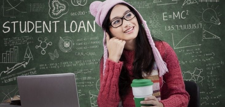 Student loan concept image with college student studying on laptop