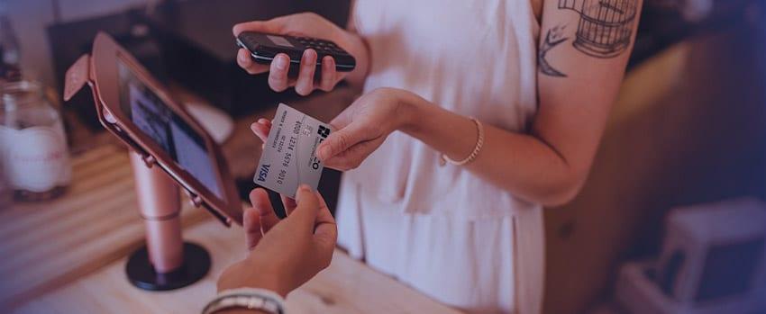 A shopper provides their Lanco FCU Platinum Visa credit card at the checkout counter